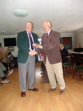 Colin Tinker receiving his 20 year tie